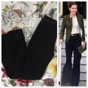 Bebe black trousers, slit on back of legs